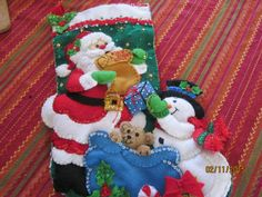 "Bucilla completed 18"" felt stocking ""Santa's List"" by HandmadebySrc on Etsy https://www.etsy.com/listing/222139087/bucilla-completed-18-felt-stocking"
