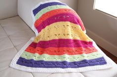 This Dragonfly Baby Blanket is the pop of color your nursery needs.