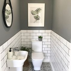 The little room with a wonderfully big tiling solution. bother the metro wall tiles with coloured grout and the patterned floor tiles. Small Downstairs Toilet, Small Toilet Room, Downstairs Cloakroom, Toilet Room Decor, Small Toilet Decor, Small Bathroom With Window, Bedroom With Ensuite, Bathroom Design Small, Bathroom Interior Design