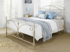 Arquette (Ivory) Bed Frame - A classical and timeless style with delicate curves and twists combined with the beautiful painted egg shell and patina accents.