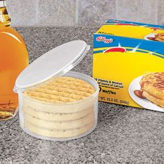 """Frozen Waffle Keeper - Keep frozen waffles fresh  frost-free without taking up valuable freezer space! Get rid of those bulky cardboard boxes that can crush or collapse. Space-saving, airtight container securely holds up to 5 round waffles. Great for frozen pancakes, too. Top-rack dishwasher safe, BPA-free plastic. (5""""Diam. x 2-1/2""""H) (Product Number AP5855) $6.98 CAD"""