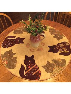 "Top your table with this """"purr-fect"""" pattern! This sweet table topper is perfect for the cat lover in your life -- even if that's you! It features 2 versions of cuddly kitties, all ready for you to dine in style! Finished size..."