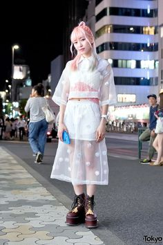 Eva Cheung on the street in Harajuku wearing a sheer and bows look by Jenny Fax (from Wall Harajuku) with Pameo Pose platforms and a Pinkland x Can… | Pinterest