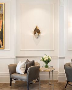 Soft touches and sophisticated details: Love these diamond-shaped wall sconces which disperse the light to create beautiful forms on the walls #knightsbridge