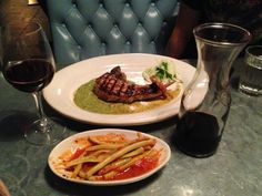 Grilled pork chop with beans in tomato sauce