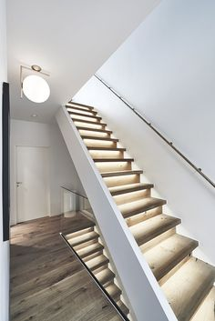 A modern staircase with LED-lights under the steps. It gives the room some light, and looks modern and stylish.