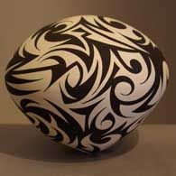 Eric Lewis black and white tribal tattoo design curving lines pottery ceramics clay. more designs on the page