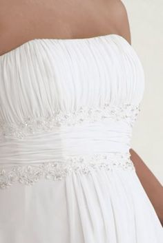 Beautifully detailed, fitted bodice flows into a soft and flowing chiffon skirt. Empire waist is accented with exquisite, hand-beaded lace and ruching detail.   Strapless A-line silhouette is universally flattering and oh-so-comfortable, making it an easy customer favorite.  Back of gown is absolutely gorgeous with beaded lace detail from waist to hem.  Chapel train.