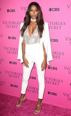 Jasmine Tookes in a lace bodysuit and white suit