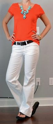 red t-shirt, white jeans, teal necklace