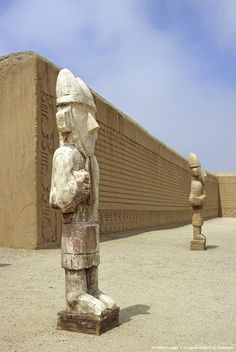 Peru, Trujillo, Chan Chan. Wooden reproductions of Chimu statues stand in the Ceremonial Courtyard of the Tschudi Complex. The Complex is part of the ancient...