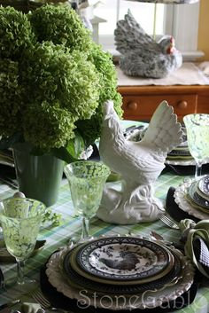 StoneGable: A Little French Rooster Tablescape-   I LOVE these black & white rooster dishes, they're beautiful and the green background is gorgeous!