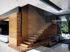 Modern wooden stairs design give a new look to a traditional material and transform a staircase into a piece of art. Wooden stairs are the most popular Contemporary Stairs, Modern Stairs, Modern Lofts, Modern Houses, Contemporary Design, Modern Mansion, Modern Art, Wooden Staircases, Stairways
