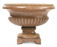 A large gilt-bronze mounted rose granite oval jardinière<br>France, early 20th century | Sotheby's