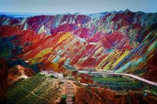 A visitor stands at a viewing platform in the Zhangye Danxia Landform Geological Park in Zhangye, northwest Chinas Gansu province.The Danxia...