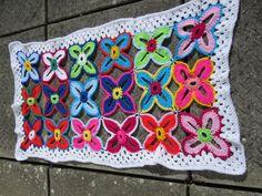 Hawaiian flower crochet baby blanket or pram rug available at www.woollygoods.com