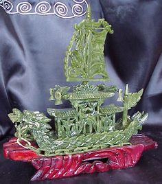 Shop for this beautiful small green jade Dragon Ship sculpture with full sails and other fine Feng Shui and Asian decor. We offer beautiful jade and bronze figurines, vases and other items to decorate your home. Jade Dragon, Dragon Boat, Jade Stone, Garden Statues, Jade Green, Carving, Pottery, Prints, Beautiful