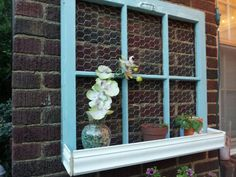 Window planter diy. Take old window and break out the glass. Paint and sand after to make it look aged. Use a staple gun to attach chicken wire to the back and screw in a heavy duty picture hanging hardware (hold at least 20lbs). Cut ceiling trim to make box planter and glue & screw to the bottom of window. Plant climbing roses or morning glories, or just leave it as cute cottage decor!