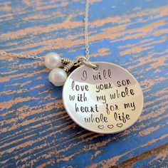 """This necklace is a great way to say thanks for all of the hours and hard work she put into shaping the man of your dreams. This necklace is sterling silver an comes with a sterling silver chain of your choice, a 1"""" sterling silver disc, and two pearls that dangle. It says """"I will love your son with my whole heart for my whole life"""".     *+*+*+*+*+This has been hand stamped *one character at a time*. Every piece is different and has it's own flare ;). There is no way I can stamp each letter…"""