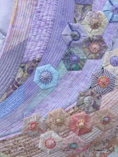 Petals in the Wind detail by Cassandra at The Not So Dramatic Life.  3D folded hexagons and yo yos. Bloggers Quilt Festival - Spring 2015.