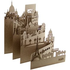 Image of PARIS | Designed by Salsarela, between Colombia and Spain, Pocket Cities are three dimensional laser-cut carboard postcards in small formats [17x11cm when folded] so they can be easily moved from place to place. They can be used as postcards or as an annotation travel guide or if you place them near a spot of light you will get the shadow projection of a city inside your home!