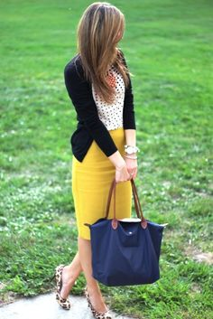 black sweater ove a white polka dotted shirt  bright yellow skirts  leopard print sandals and a navy blue hand bag