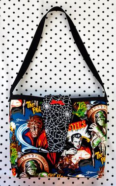 Classic Horror Movie Monsters Purse with Webs Coffin Flap. This one's got a magnetic snap - $16.99 - Sabbie's Purses and More