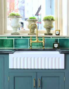 Beautiful kitchen sink area with brass faucet