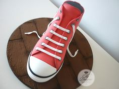 I made this cake for a teenage girl who loves her Converse trainers :)