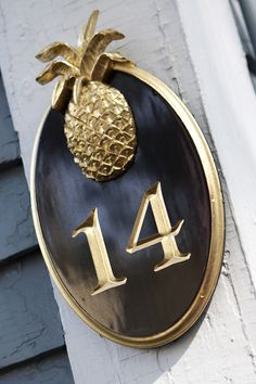 """Pineapple house number plaque. """"Previous pinner wrote: """"I love this house number plaque. The black and gold makes it very elegant and since pineapples are the symbol for hospitality, it's very fitting to have it greet you in the front of your home. I used to have a pineapple door knocker on my front door. Now I'm wishing I took it with me…Sigh...."""" #house #number #signs"""
