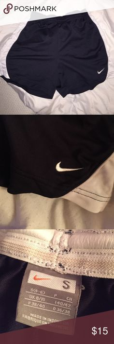 NIKE athletic shorts LIKE NEW navy blue & white nike athletic shorts ! No flaws. So comfy. Nike Shorts