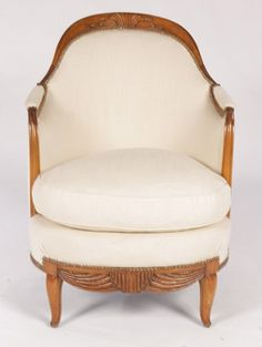 A good and unusual pair of carved Art Deco club chairs circa 1930.