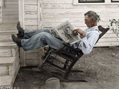 Farmer reading Progressive Farmer magazine on his farm, Coryell County, Texas, September 1931, photo by George W. Ackerman