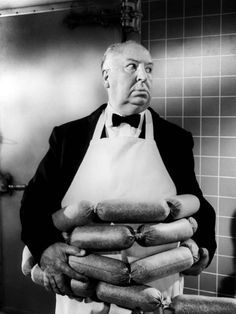 Alfred Hitchcock wrapping himself in giant sausages
