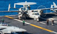 """Sailors work on an E-2C Hawkeye from the """"Black Eagles"""" of VAW-113 aboard USS Carl Vinson (CVN 70). (U.S. Navy Photo by Mass Communication Specialist 3rd Class Elton Charles Wheeler/Released) PACIFIC OCEAN – (Jan. 15, 2018) –"""