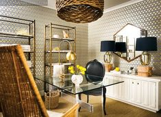 Rattan chair and light pendant, David Hicks wallpaper, white lacquered credenza, vintage etageres. Office inspiration.
