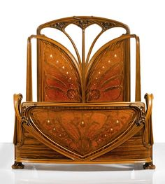 "Louis Majorelle |  ""AUX ORCHIDÉES"" BED -  walnut and macassar ebony with thuya, amaranth, bois des îles and burl amboyna marquetry and mother-of-pearl, copper inlays. 72 3/8  x 65 1/8  x 90 3/4  in. (183.8 x 165.4 x 230.5 cm) -  circa 1899-1900."