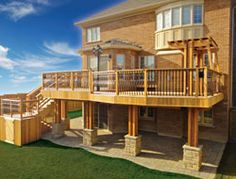 2 level cedar deck with wrought iron railings, pergola and stone walkout basement - Toronto Landscaping & deck building Company | Interlocking, Railings, Outdoor Kitchens, Pool Builders