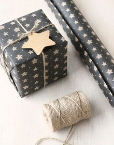 Black wrapping paper with rustic star design, kraft brown on reverse. 3 metre roll, perfect for Christmas gift wrap, paper width 50cm.