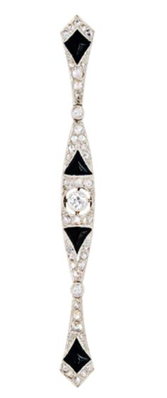 An Art Deco Onyx and Diamond Bar Brooch, circa 1920 The elongated tapering plaque decorated with onyx, old European-cut and rose-cut diamonds, mounted in platinum and 18k gold, French assay marks