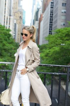 A classic trench coat over a simple white tee and skinny jeans