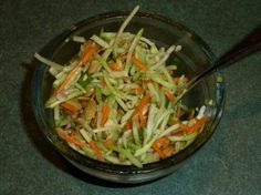 Broccoli Slaw from Food.com:   This broccoli slaw in delicious - given to me by a friend so I don't know where it originated. It's better freshly made and not refrigerated. You can buy broccoli slaw in the prepackaged lettuce area of most supermarkets.
