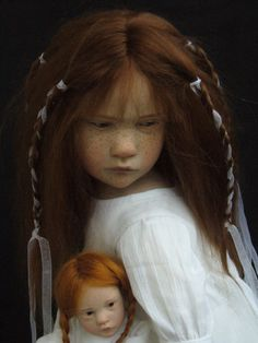 Beautiful lifelike doll with brown hair by Laurence Ruet