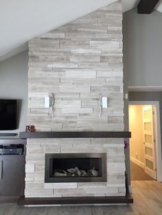 New fireplace install by Dominion Tile ft @ErthCOVERINGS Large Format Silver Fox Strips!