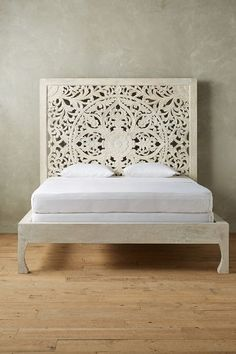 Lombok Bed - carved mango wood in white (also natural) -- queen $2.7k from anthropologie.com
