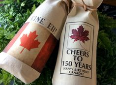 ** HOW TO PURCHASE WITH A CREDIT CARD THROUGH PAYPAL (YOU DO NOT NEED TO HAVE A PAYPAL ACCOUNT): www.etsy.com/help/article/361   This is for two custom made cotton fabric wine bags which say CHEERS TO 150 YEARS. HAPPY BIRTHDAY CANADA! and WINE,EH!.  Sale priced at only $5 each. Well made with serged edges.  Wine/gift is not included.