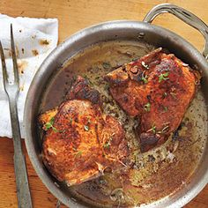 Andouille-Stuffed Pork Chops... Yum......makes me hungry...for those of you who aren't from Louisiana....Andouille is a coarse-grained smoked sausage made using pork, pepper, onions, wine, seasonings and used in Cajun cooking