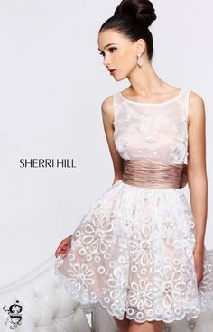 GRADUATION PARTY DRESS I WANT SO BADLY!!!!!! We are Loving this precious mini from Sherri Hill! It's sweet, whimsical and a little angelic! Sherri Hill 21144 has a sheer modest top with a satin belted waist and a skirt that flares out just a touch. Pearls, crystals, and lace make up a beautiful design throughout the dress giving it a dainty yet glamorous look. Our favorite part has to be the back of the dress however, a deep V and precious oversized bow just tops off this amazing mini!
