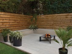 It once looked like the answer to every garden's prayer, but nothing dates your outside space like worn-out decking. Try wood effect porcelain paving instead! Backyard Ideas For Small Yards, Small Backyard Landscaping, Backyard Retreat, Landscaping Design, Small Patio, Deck Alternatives, Back Garden Design, Deck Design, Patio Tiles