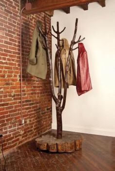 "Tired of coats, scarves and backpacks slung over your furniture? Put an end to the clutter with this coat tree. It's easy to make, and it will add a ""wow"" factor wherever you choose to display it.        Read more: http://www.motherearthnews.com/multimedia/image-gallery.aspx?id=2147494311&seq=1#ixzz1hEefF0cX"